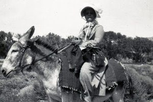 Eva Fenyes on a burro