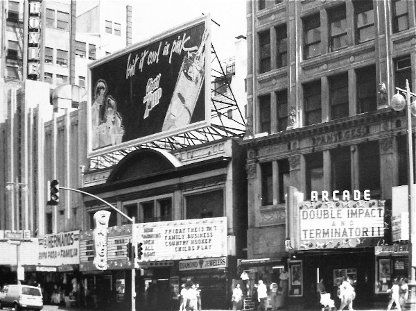 View of the Roxie, Cameo and Arcade theaters on Broadway in Los Angeles, c. 1991. Accessed at https://sites.google.com/site/downtownlosangelestheatres/arcade