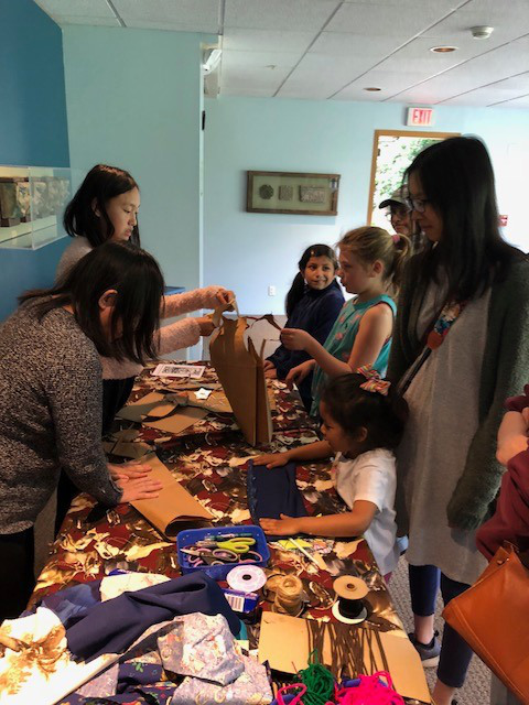 NCL volunteers help guests make their own cowpoke vests with crafts by Art2Go during MOTA Day 2019. Photo by Brad Macneil.