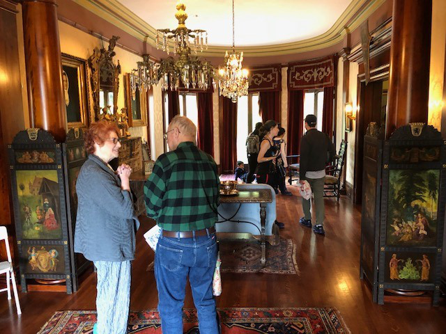 anet Kadin, President of the Volunteer Council and longtime docent, gives a mini tour of the Fenyes Mansion during MOTA Day 2019. Photo by Brad Macneil